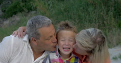Grandparents kissing dear grandson Stock Footage