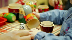 Child hand plays with russian doll - matrioshka Stock Footage