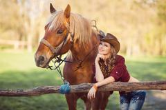 Horse and girl with cowboy hat - stock photo