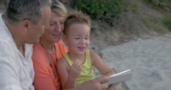Child spending time with grandparents and pad Stock Footage