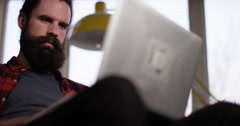 4K Serious man working on laptop computer & staring intently at the screen Stock Footage
