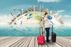 Couple shows thumb up with the world landmark - stock photo