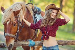 Woman and Horse. Wild West Retro Style - stock photo
