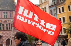 people with flags during the demonstration against misery and poverty - stock photo
