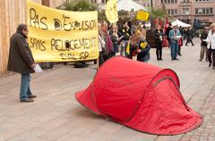 People with banner during the demonstration against misery and poverty Stock Photos