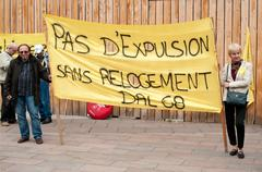 people with banner during the demonstration against misery and poverty - stock photo
