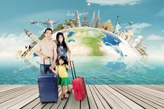Family with bag and ready for the world tour - stock photo