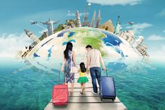 Family with suitcase and the world landmark - stock photo