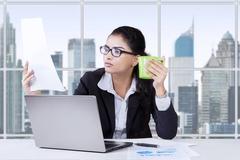 Female entrepreneur enjoy coffee while working Stock Photos