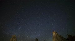 Astrophotography Time Lapse of Milky Way Rising over Trona Pinnacles -Tilt Down- - stock footage