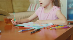 Portrait cute girl 7 years old sitting in the table and smiling at camera Stock Footage