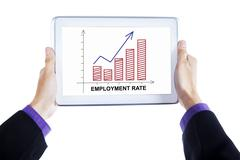 Hands hold tablet with employment rate chart - stock photo