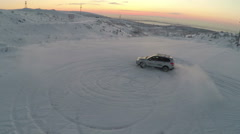 Flying over the car drifting on snow Stock Footage