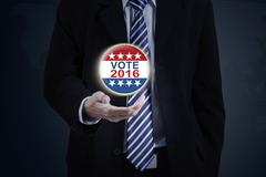 Male hand holding vote symbol Stock Photos
