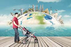 Man with stroller travel to the world landmark - stock photo