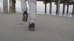 Man runs along the beach. - stock footage