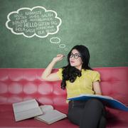 Young woman learns foreign language - stock photo