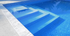Stairs in outdoor swimming pool Stock Footage