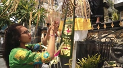 Woman decorating a penjor on Galungan day Stock Footage