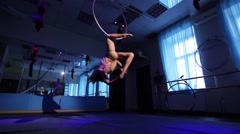 Aerial acrobat woman on circus stage. tricks hoop on a blue background Arkistovideo