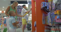 Mother, father and son in toy shop Stock Footage