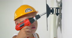 Child playing a repair at home Stock Footage