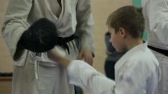 Karate Kid Kicking On Bag Stock Footage