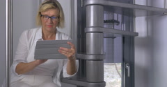 Mature Woman in Glasses with Tablet Stock Footage