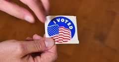Peeling Off I Voted Sticker Stock Footage