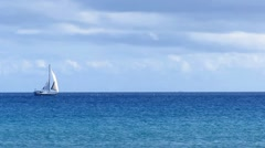 Grey white sailboat crossing ocean Stock Footage