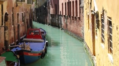 Small canal with green turquoise water in Venice, Italy Stock Footage
