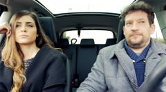 Couple not able to fight starting to laugh in car funny 4K Stock Footage