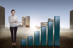 Asian business woman show increase chart Stock Photos
