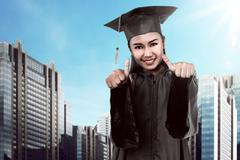 Asian college student graduate from university Kuvituskuvat
