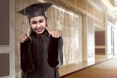 Asian college student graduate from university Stock Photos