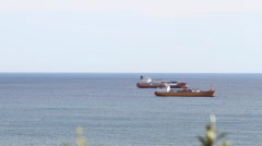 Freight ships anchored in the open sea Stock Footage