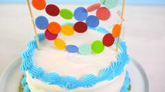 Simple white Birthday cake with cake garland. Stock Footage