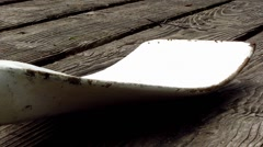 White rowing blade of rowboat on wooden jetty - stock footage