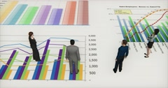 Stock Video Footage of 4k business team standing on the finance pie charts & stock trend diagrams.