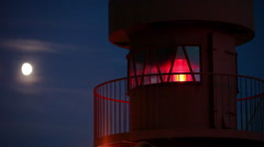 Lighthouse and the waxing moon Stock Footage