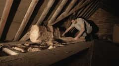 Adult Man insulating attic with insulation material Stock Footage