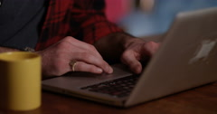 4k, Attractive hipster guy working on a laptop in a coffee shop. - stock footage