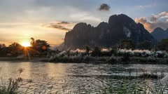 Timelapse of sunset in Vang Vieng, Laos Stock Footage