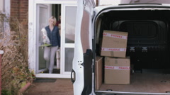 Adult Couple moving out of home with boxes and homeware - stock footage