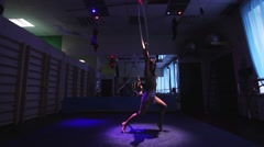 Aerial acrobat woman on circus stage. tricks hoop on a blue background - stock footage