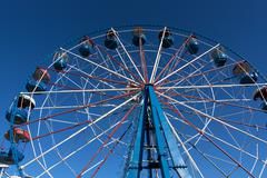 The Ferris whee waiting to entertain guests of the park - stock photo