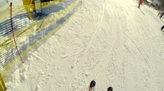 A man walks down the mountain slope on skis Stock Footage
