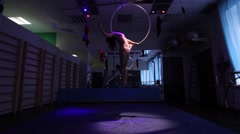 Aerial acrobat woman on circus stage. tricks hoop on a blue background Stock Footage