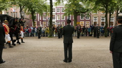 The Queens Carriage Rides Past the Military - The Hague Netherlands Stock Footage