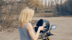 Sexy girl on the motorcycle removes her helmet slow motion Stock Footage